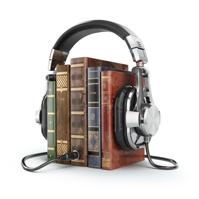 Audiobooks concept. Vintage books and headphones.